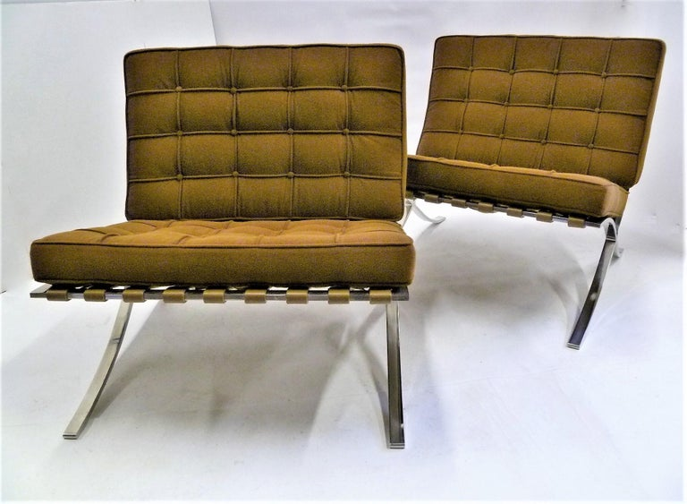Pair of fine 1960s Knoll Barcelona chairs designed by Mies van der Rohe. This pair produced in the 1960s. Reupholstered in a Knoll Spencer in Caramel micro-loop cocoa brown fabric with original leather straps underneath. Original Knoll tag attached,