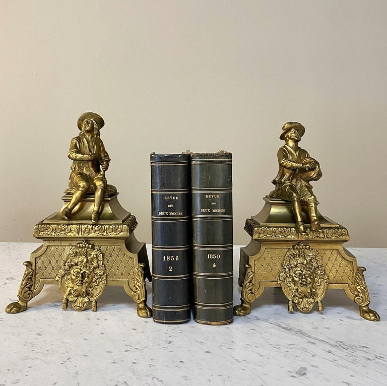 Pair of 19th century bronze Andiron bookends can be a charming accent to your decor, and are amazingly versatile! Originally crafted as decorative items for a small coal fireplace, each depicts a well-dressed man seated, one with a pestle and the