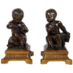 Pair 19th Century Bronze Putti Holding a Dove and Cage