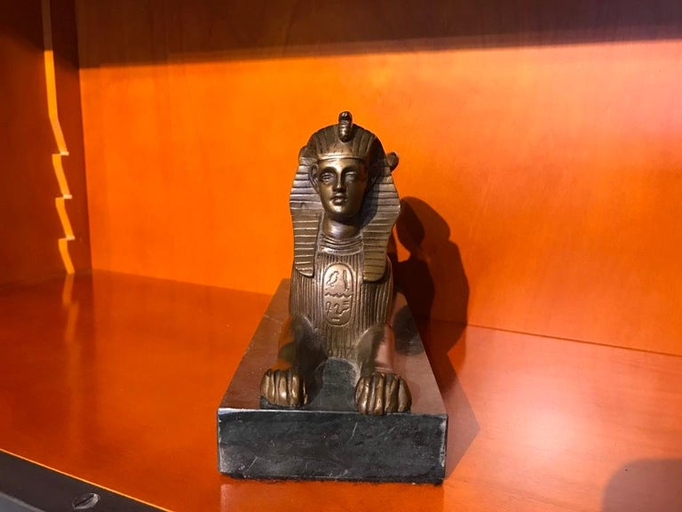 Cast Pair of 19th Century Bronze Winged Sphinx on Marble Bases For Sale