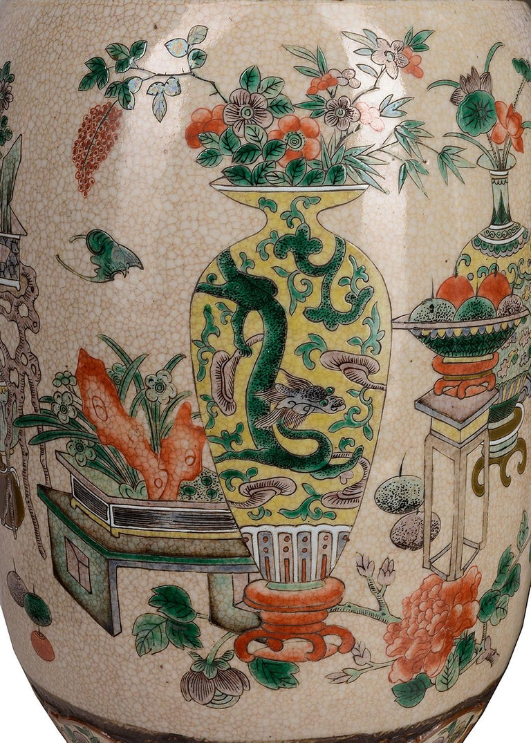 An impressive pair of 19th century Chinese crackle-ware vases, each with hand painted classical motif and leaf decoration to the necks and bases. Various Chinese vases, jardinières and stands with flowers and plants to the center. We can have the