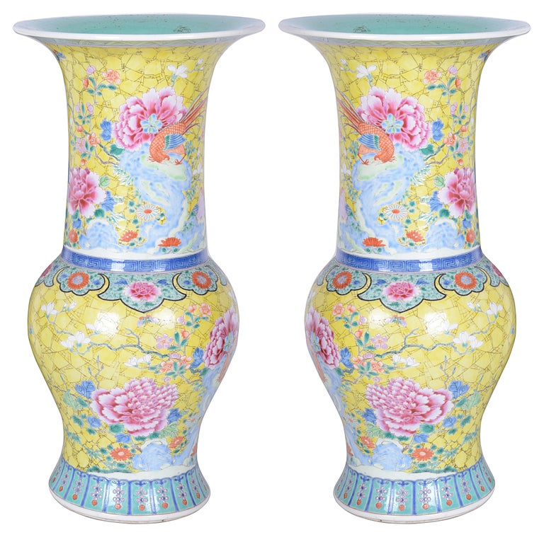 A beautiful pair of late 19th century Chinese famille rose vases / lamps, each having Yellow ground with ecotic birds and flowers.