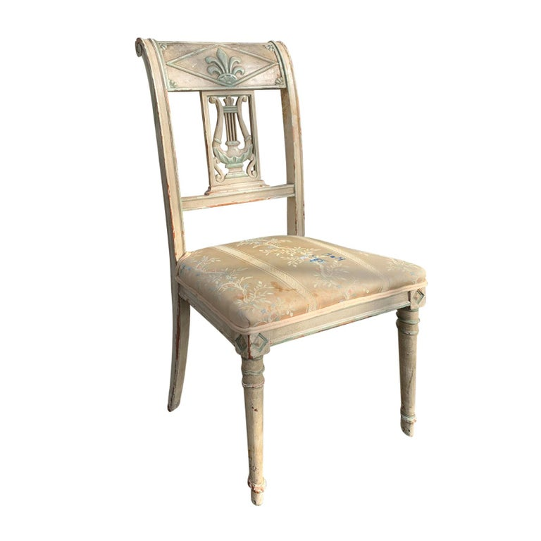 Pair of 19th century French Directoire style painted side chairs.