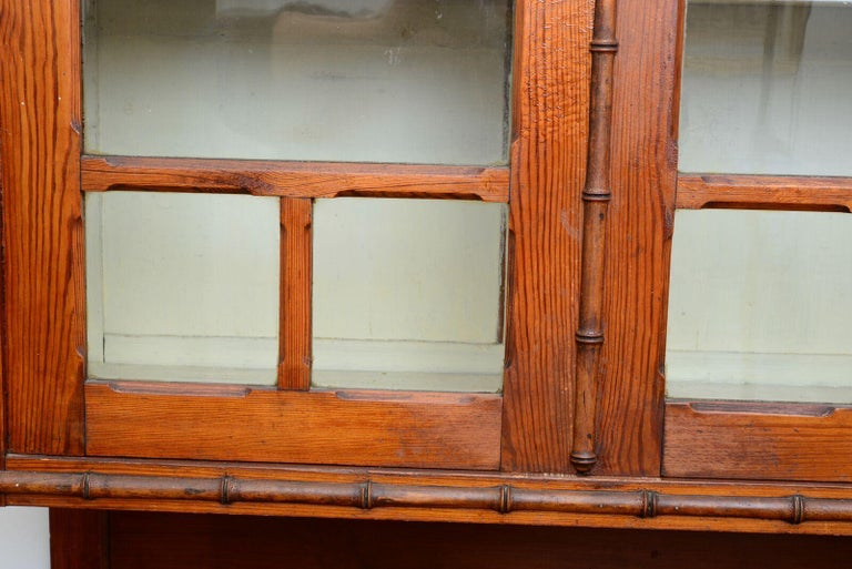 This exceptional pair of cabinets was made circa 1880 in France and are crafted of pine and made to resemble bamboo. During the late 19th century bamboo an exotic and foreign material was very prized as a symbol of colonial power and world success.