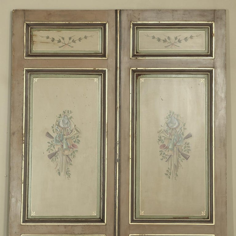 Amazing and exquisitely paneled, hand painted in French Hunting style over a hundred years ago, this pair of antique 19th century Interior doors will make a great addition to architectural design of the home. Exquisitely hand painted and crafted in