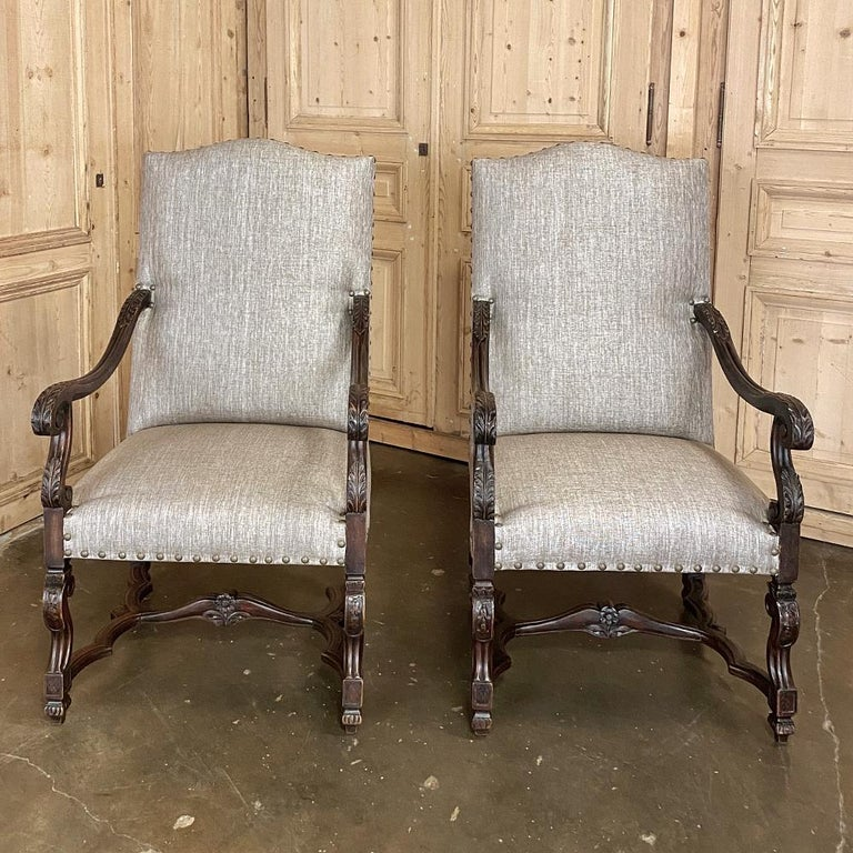 Pair of 19th century French Louis XIV walnut fauteuils or armchairs are a handsome addition to any room, one that affords ample comfort as well! Newly upholstered in Fine fabric with a distinctive neutral gray coloration, each features the trademark