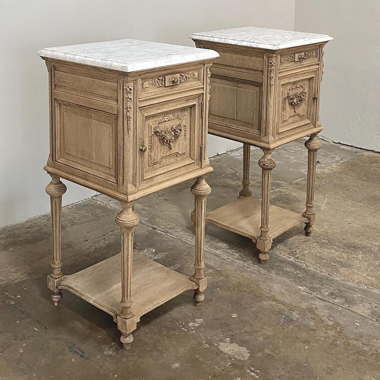 Pair of 19th century French Louis XVI marble-top nightstands were sculpted from solid oak and left in a natural unfinished state to create a casual elegance perfect for today's relaxed decors! Ideal as side tables in any family room because they're