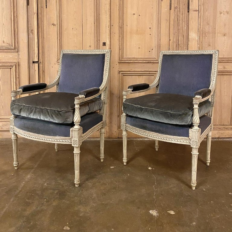 Pair of 19th century French Louis XVI painted armchairs ~ Fauteuils are perfect for adding an opulent touch to your decor, while simultaneously providing a soft visual accent, thanks to the painted finish which has achieved a lovely patina over the