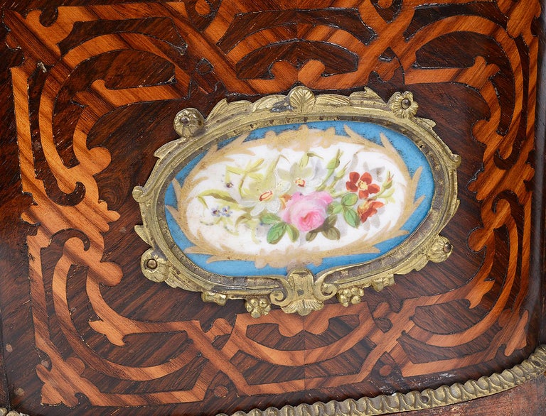 A good quality pair of French 19th century marquetry inlaid oval table jardinières, each with a brass pierced gallery, scrolling Tulipwood inlay around the Sevres style porcelain plaques that have a boarder of turquoise, hand painted flowers and an