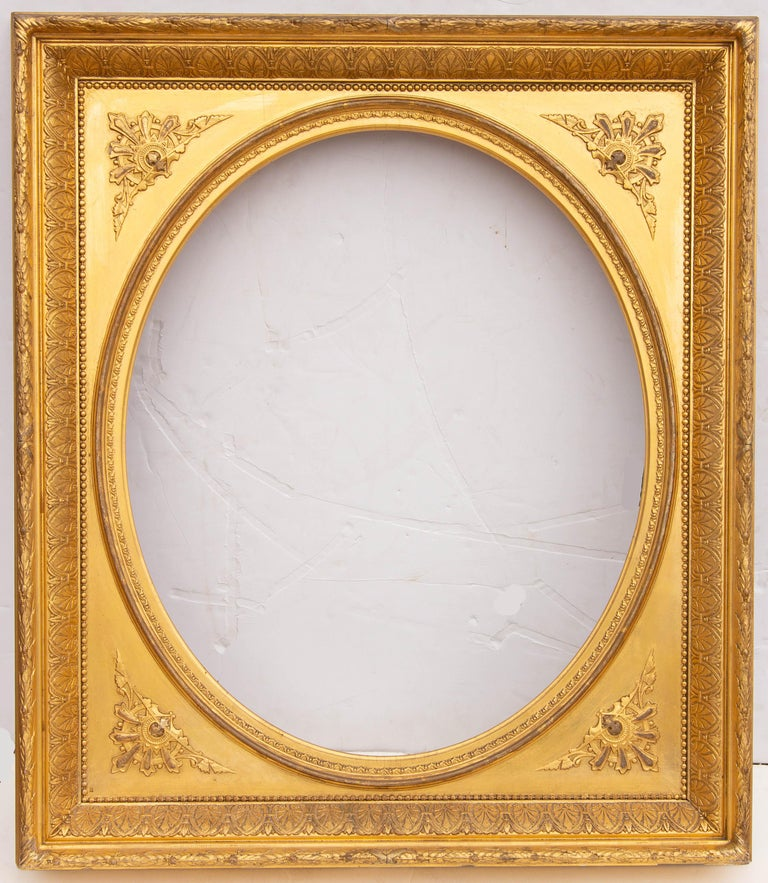 Pair of American antique giltwood mirrors.