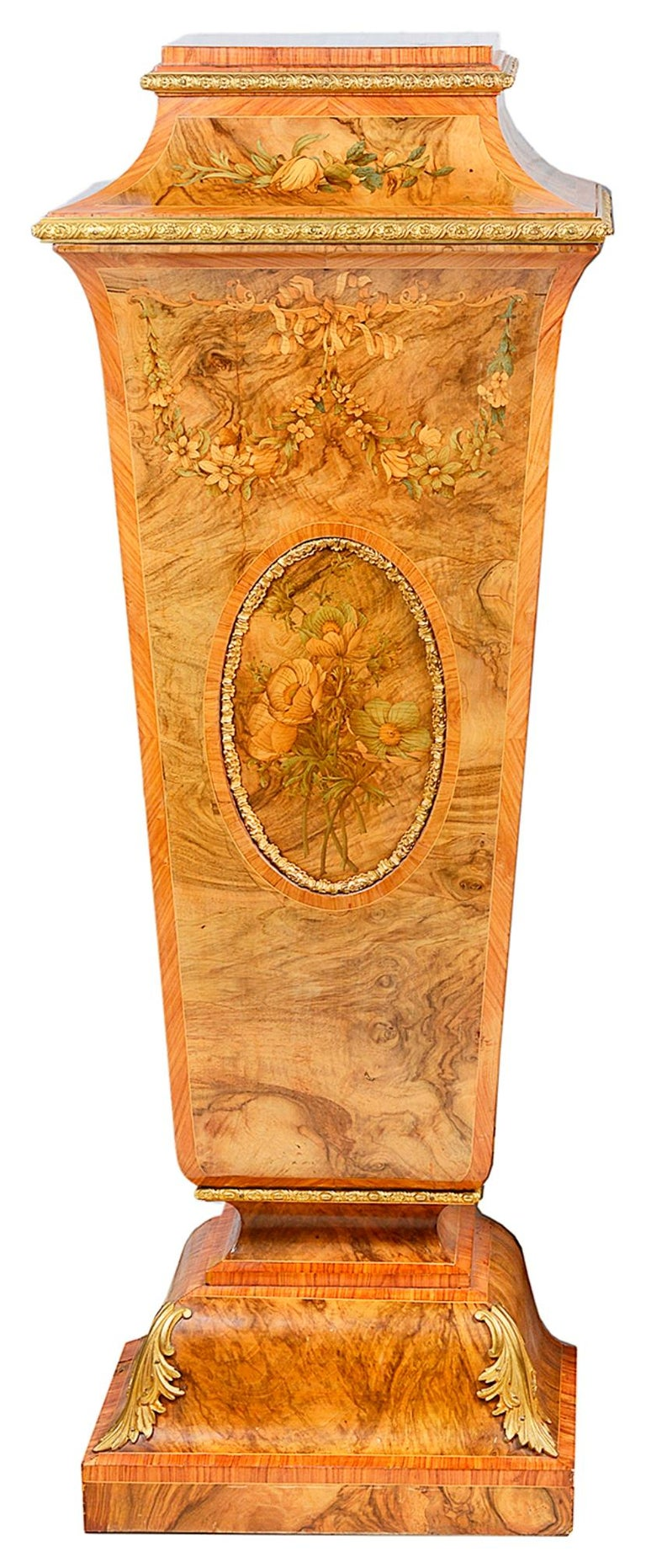 A very good quality pair of 19th century walnut pedestals, each with gilded ormolu mouldings, marquetry inlaid decoration of flowers and foliage, both having oval recessed panels again with beautiful marquetry decoration. A door to each opening to