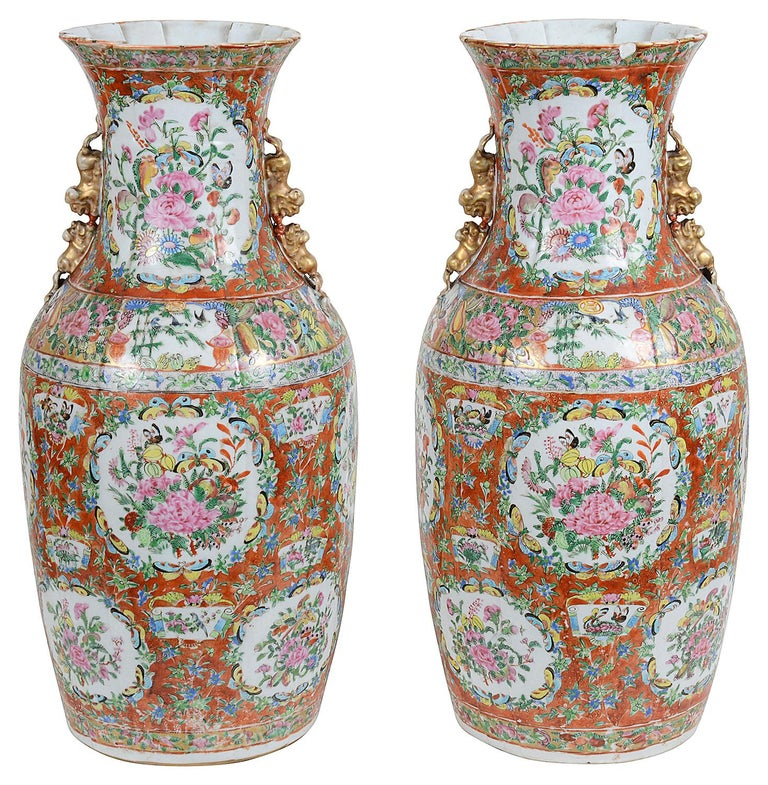 A very good quality pair of 19th century Chinese Cantonese, Rose medallion vases, each with unusual orange ground, inset painted panels of exotic flowers, foliage and butterflies, a pleated neck and mythical dog of foo handles.