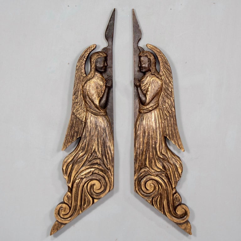 Pair of Scottish chip carved angels was originally created to hang on either side of a doorway, circa 1880s. Dark stained wood has been professionally finished with gilding wax to accentuate carved details. Angels are sold and priced as a pair.