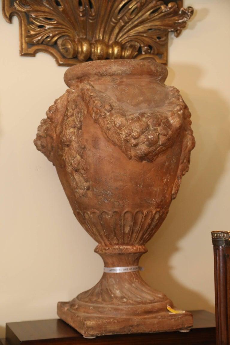 Molded Pair of 20th Century Italian Terra Cotta Urns For Sale