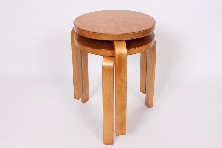 Early Alvar Aalto for Finsven model 60 beech and birch nesting tables. With reinforced tripod bentwood legs. Measures: 13 D seat. Classic. Modernist. Rarity. Finsven label to underside.