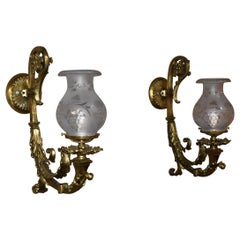 Pair of Antique Brass Ornate Wall Sconces Astral Cut and Polished Glass Shades