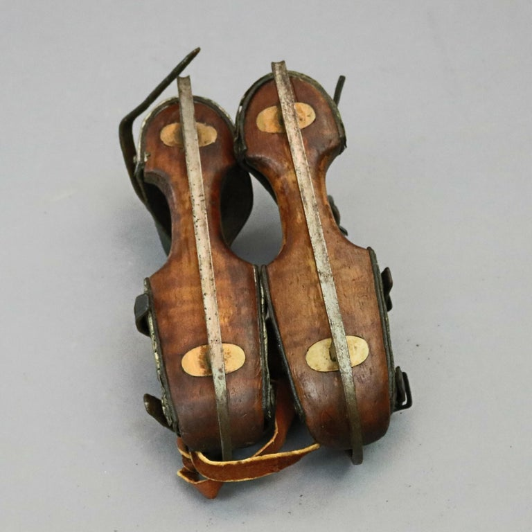 American Pair of Antique Buckled Leather and Wood Ice Skates, 19th Century For Sale