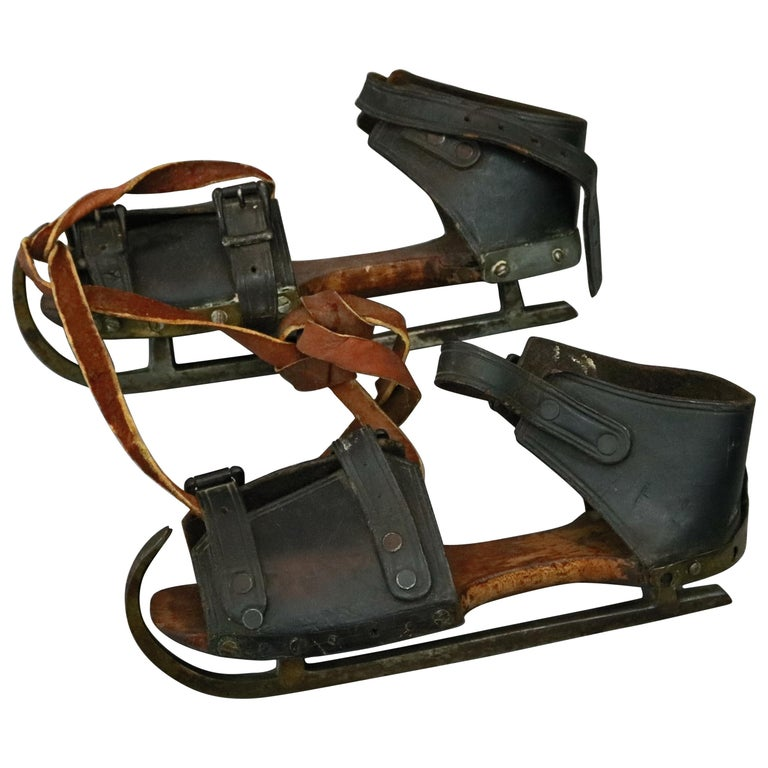 Pair of Antique Buckled Leather and Wood Ice Skates, 19th Century For Sale
