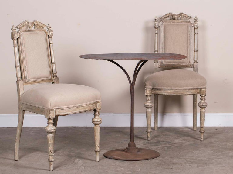 A pair of (two pair in stock) antique French Napoleon III period painted chairs circa 1870 found in a stylish house near Nice. Please notice the terrific architectural back to this set of six French painted chairs topped with an open pediment