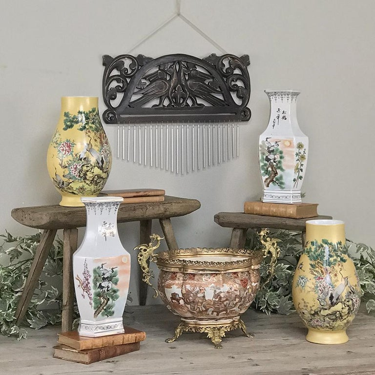 Pair of antique hand painted Chinese vases exhibit beautiful artistic scenes with exotic birds, flowers and a forest sunset enhanced by the whiteness of the Kaolin clay. circa early 1900s Each measures 14 H x 7 W x 5 D.
