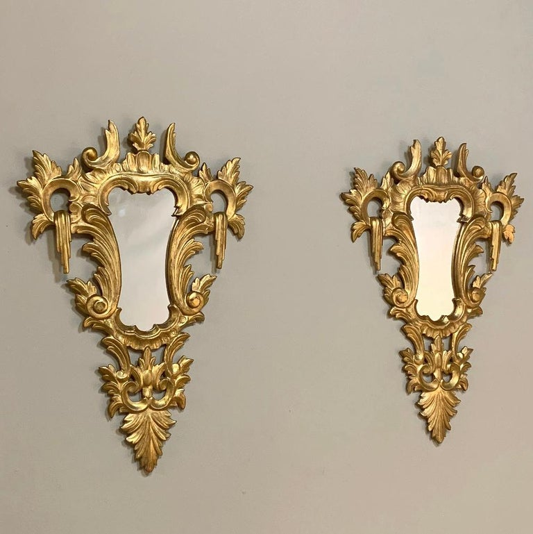 Pair of antique Italian Baroque carved giltwood mirrors will make great wall accents, and were carved from solid carved wood before the gold finish was applied, typical of Italian craftsmanship, circa mid-1900s Each measures: 30.5H x 21W.
