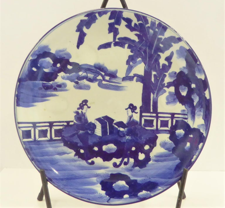Japonisme Pair of Antique Japanese Imari Blue White Chargers with Geishas at Lake Side For Sale