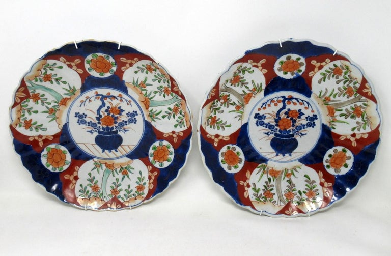 Stunning identical pair large Japanese or Chinese circular form Imari deep cabinet plates or centerpieces with ribbed surfaces and wavy rims, of outstanding quality, made during the last quarter of the 19th century.  Hand decorated with all-over