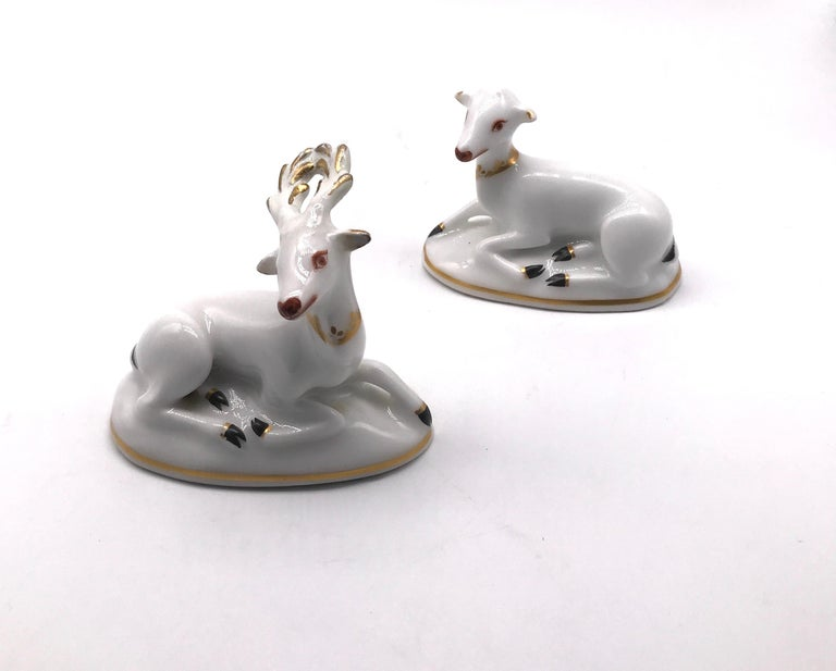 Though deer were frequently shown in porcelain, this is a rare pair of toy deer that were meant to be together and were kept together, in perfect condition, circa 1820. The pair includes a doe and stag in white and gilt, lying on an oval base,