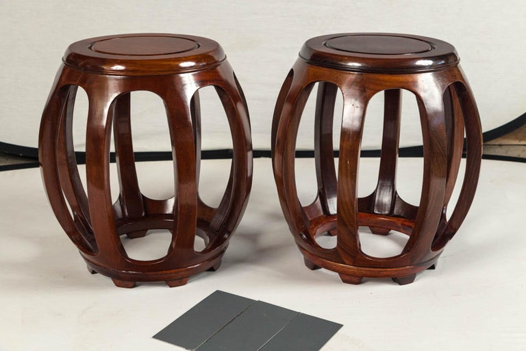 Pair of Asian rosewood garden stools, mid-20th century. Barrel shape form. Beautiful rich patina and grain.