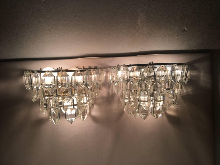 A elegant pair Austria sconces with four tires crystal on silver plated fixture. Each fixture requires three European E14 candelabra bulb, each bulb up to 40 watts. Price listed is for pair.