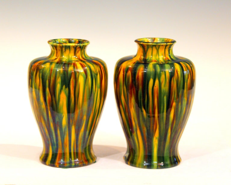 Pair of Awaji Pottery garniture vases in striking Art Deco yellow flambe glaze, circa 1930. Impressed marks. Measures: 7