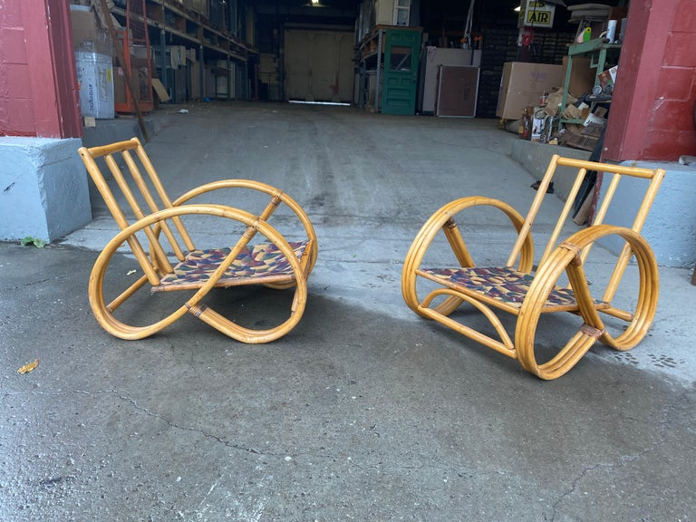 Pair of bamboo Art Deco Pretzel lounge chairs attributed to Paul Frankl, Classic 1940s, 1950s Triple banded Bamboo lounge chairs, cushions reupholstered at some point, fairly recent, perfect scale and proportion, nice original patina, surface,