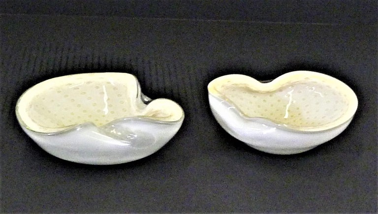 1950s Murano Mid-Century Modern Italian hand blown vessels by Alfredo Barbini. Controlled swirl bubble pattern of gold inclusions against a white background and white reverse bottom in a biomorphic shape. Lovely as catch-all vessels or