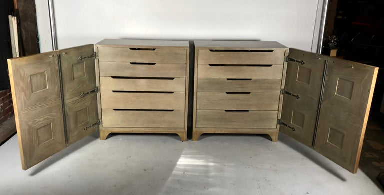 Stunning pair of Bi-fold panel front 5-drawer Cerused oak dressers by Romweber Furniture Co. Regency modernist design. Superior quality and construction, amazing design and proportions. Retains original color, surface, patina. Five generous divided