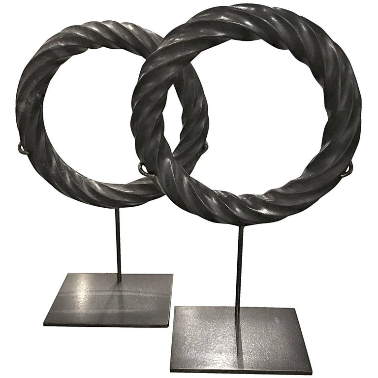 Pair of Black Twisted Marble Ring Sculptures on Stands, China, Contemporary