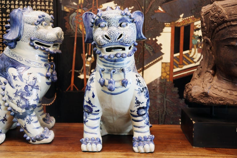 Porcelain Pair Blue and White Chinese Foo Dogs Hand-Painted, Private Chinese Collection For Sale