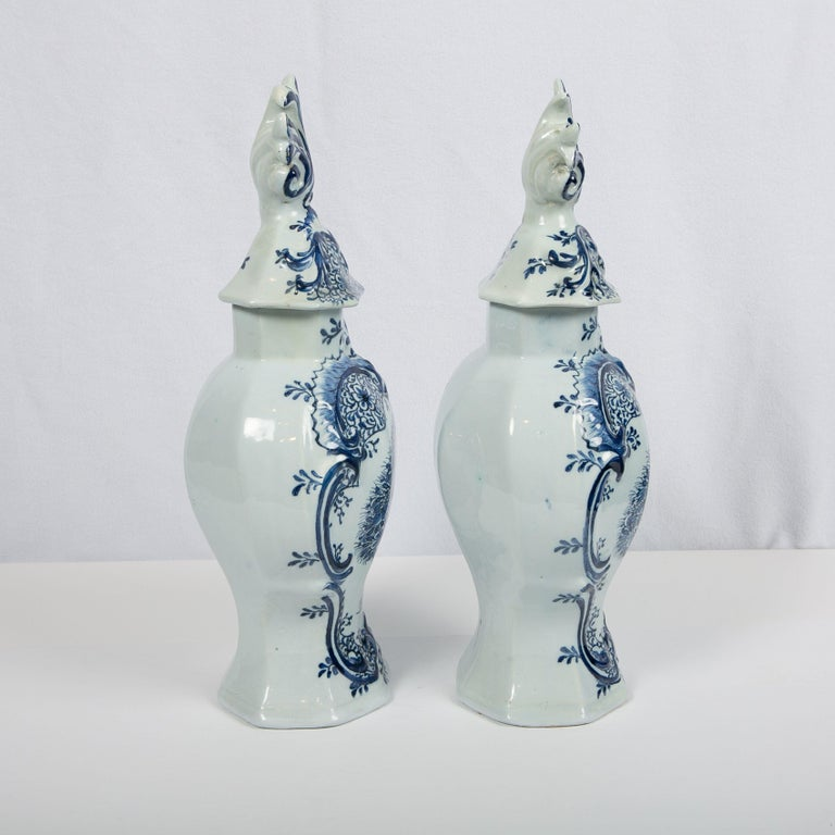 This pair of large blue and white Dutch delft mantel (fireplace) jars were made by