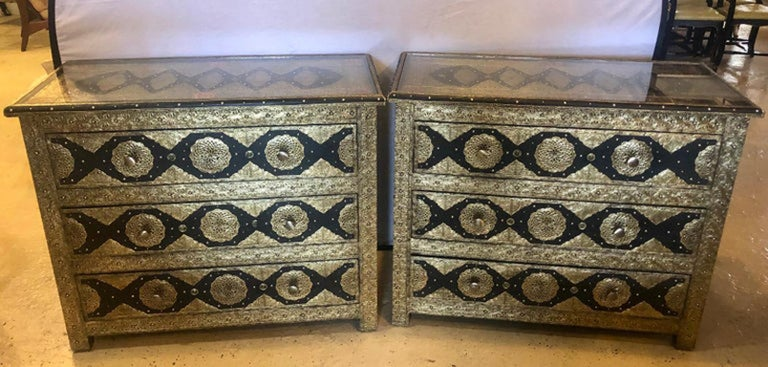 Pair of brass and ebony natural stone and leather inlaid Moroccan commode, chests or nightstands. These exceptional chests depict and compliment the Hollywood Regency era at its finest. Each featuring amazing intricate latticework on silver-toned