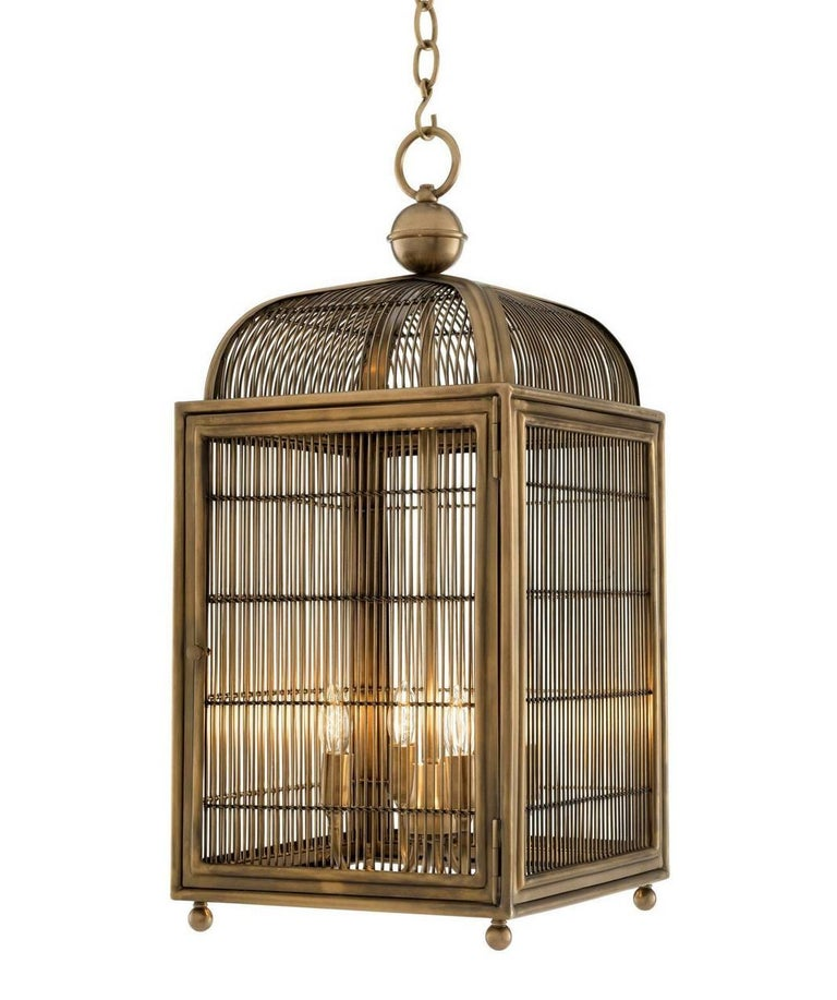 Stunning pair of modern brass four-light ceiling lanterns produced by Eichholtz in Germany, of square form and generous proportions  Bring elegant style to your home with the falcon lantern. This enchanting birdcage Luminaire owes its name to the