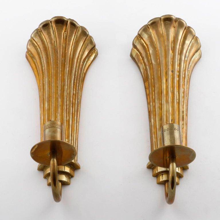 A pair of Art Deco brass one-light wall sconces designed by Lars Holmstrom for Konstsmide Arvika, Sweden, manufactured in 1920s-1930s.