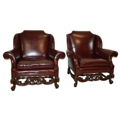Pair Burgundy Wing Back Club Chairs Heavily Carved Walnut Frame