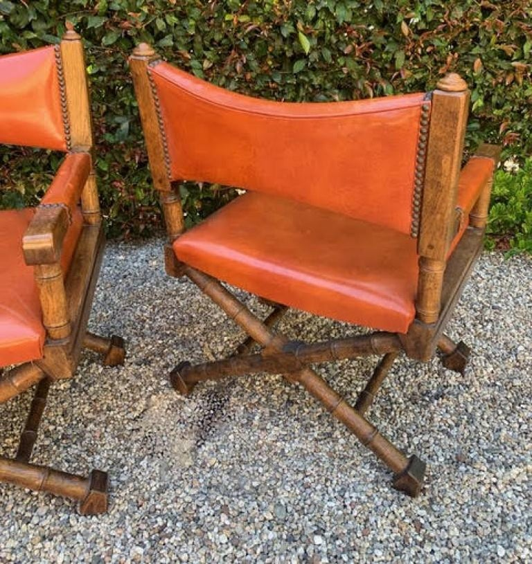 Mid-Century Modern Pair of Campaign Style Leather and Wood Chairs For Sale