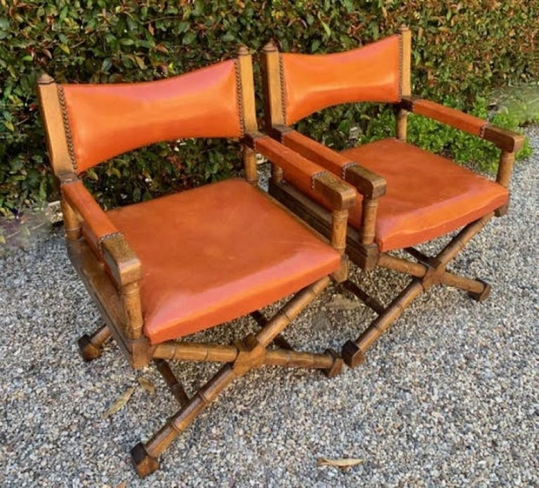 Pair of Campaign Style Leather and Wood Chairs In Good Condition For Sale In Los Angeles, CA