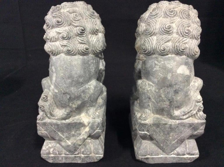 Archaistic Pair of Carved Stone Foo Dogs For Sale