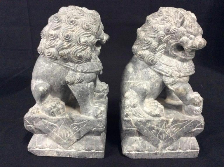 Chinese Pair of Carved Stone Foo Dogs For Sale