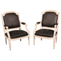 Pair Carved White Paint Decorated French Louis XVI Style Armchairs with Leather