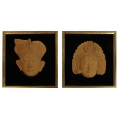 Pair of Carved Wood Figural Framed Wall Sculptures