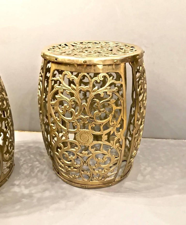 Great pair of cast brass stools with the casting in the form of scrolling vines and central floral motif. These stools are a bit taller than the standard garden seat height. They are true standouts.