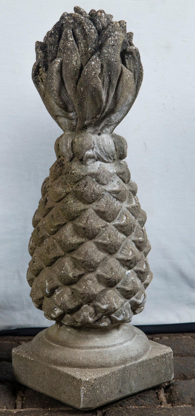 High relief pair of cast stone pineapple garden ornaments. Marked Henri Studio Inc Palatine Ill.