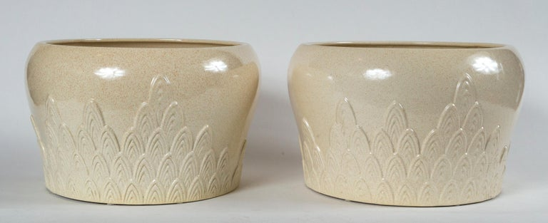 Pair of ceramic planters, Tommaso Barbi, Italy, mid-20th century. A striking pair of planters with raised, arched design and stippled glaze. Signed Tommaso Barbi, Ceramiche, Italy. A post war Italian artist, Barbi worked with a variety of materials